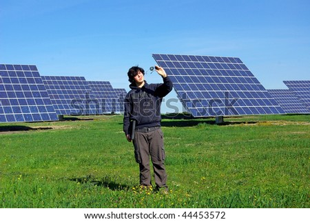Young man near the central photovoltaic.