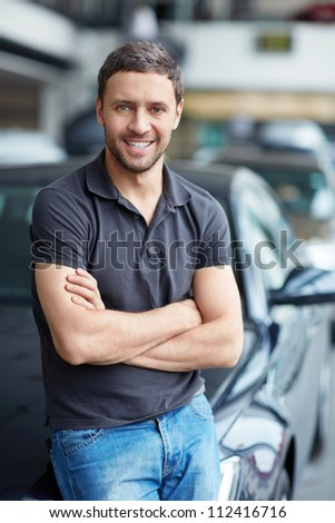 Young man next to the car