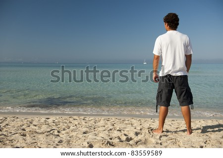 Young man on a beach in Majorca, Balearic Islands, Spain.