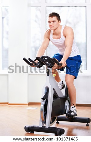 Young man on a bicycle simulator