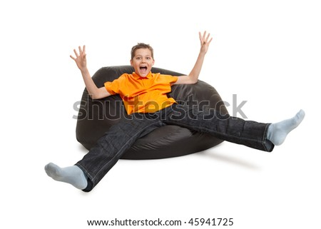 young man on bean bag isolated on white