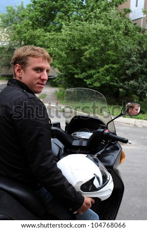 young man on motorbike