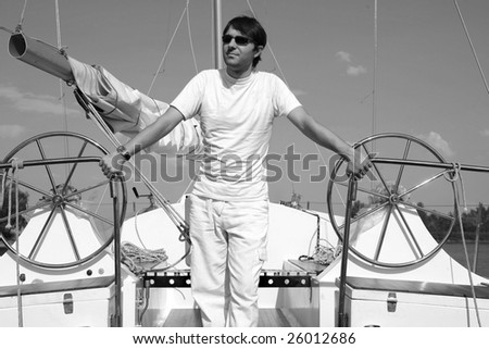 Young man on sailboat desk look.
