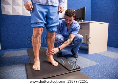 Young man on study of the tread in a podiatry cabinet