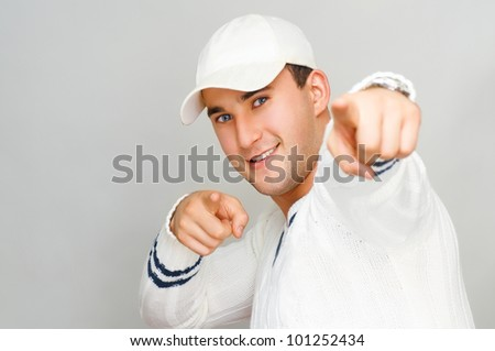 young man on the grey background