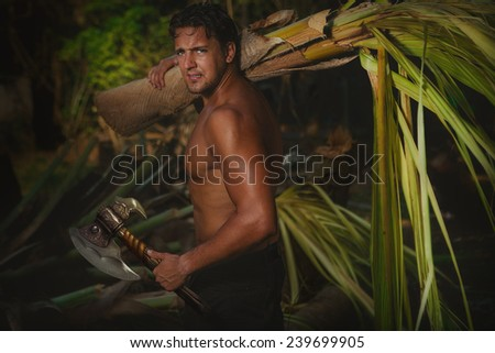 Young man on vacations with a palm tree