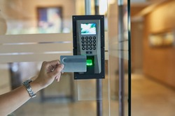 Young man or woman use key card for enter digital security door systems