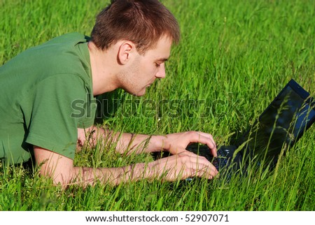 Young man outdoor with laptop #52907071