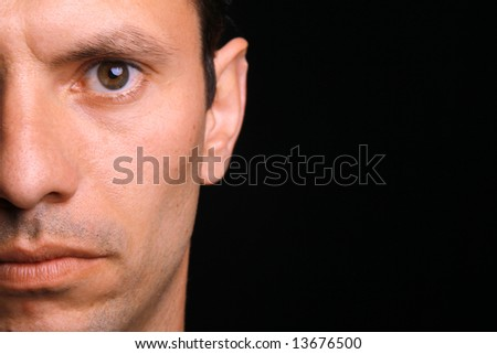young man over black background (half portrait) - stock photo