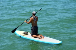 Young man paddle boarding on Biscayne Bay off Miami Beach,Florida