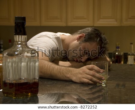 young man passed out from alcohol - stock photo