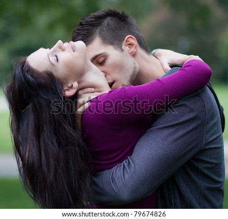 Young man passionately kissing his girlfriend on the neck