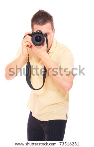 young man photographer taking pictures with his DSLR