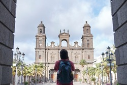 Young Man Photographer Traveling And Taking Photos of An Old Spanish Cathedral