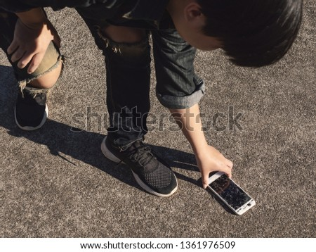 Mobile phone drop to the floor Images and Stock Photos