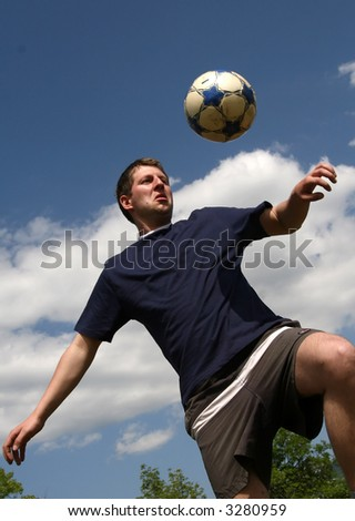 young man play with soccer ball