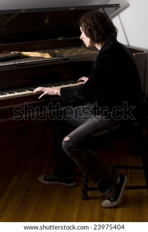 Young man playing a piano.