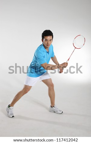 Young man playing badminton