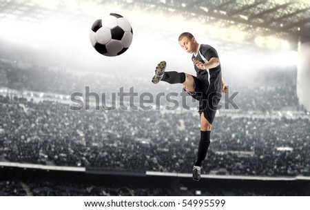 Young man playing football in a stadium
