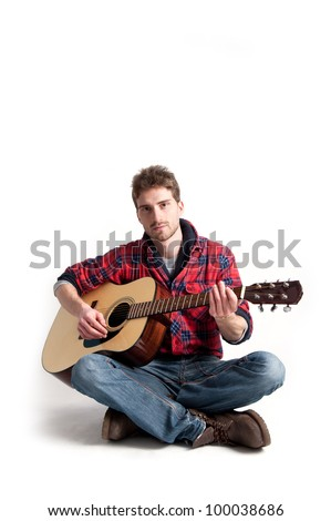 Young man playing guitar against white background.