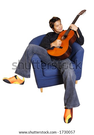 Young man playing guitar (isolated)
