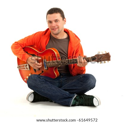 young man playing on orange electric guitar