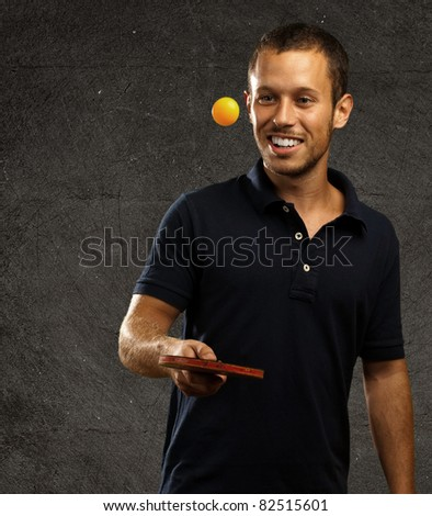 young man playing ping pong against a grunge background