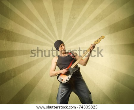 Young man playing the bass guitar