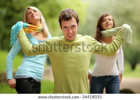 Young man playing with two girls. Shallow DOF.
