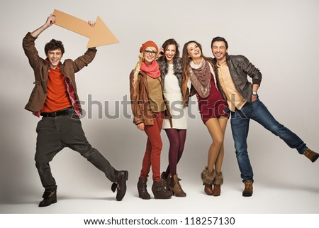 Young man pointing at group of friends