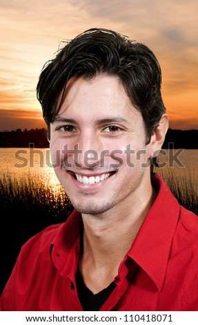 Young man posing at the beach at the ocean