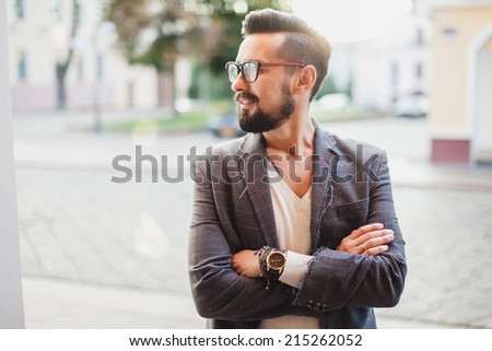 young man posing on the street