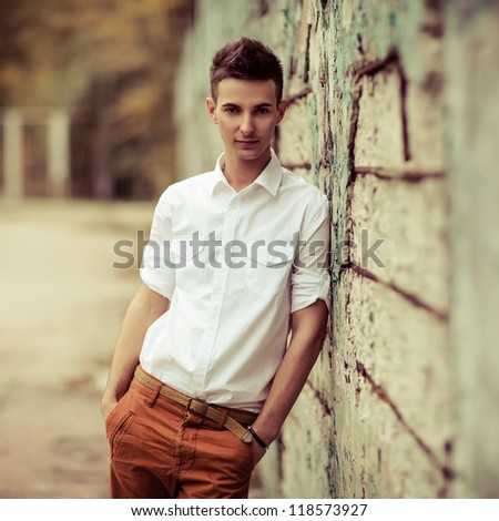 Young man posing outdoors