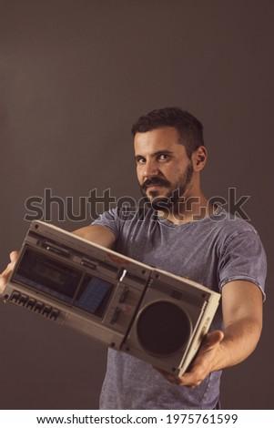young man posing with a mini chain Zdjęcia stock ©
