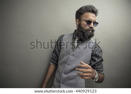 young man posing with beard in...