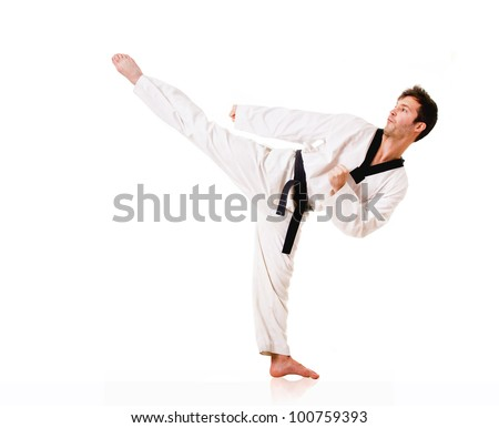 Young man practicing martial arts over white background