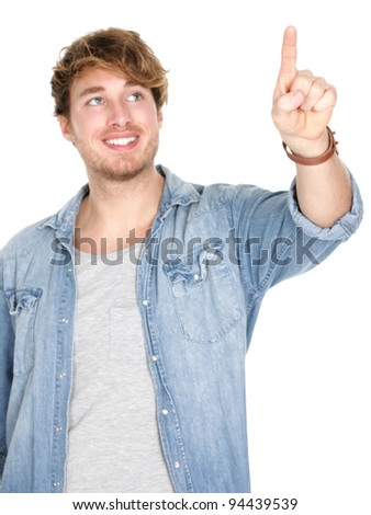Young man pressing / pushing button isolated on white background. Young handsome smiling happy casual caucasian male in his 20s.