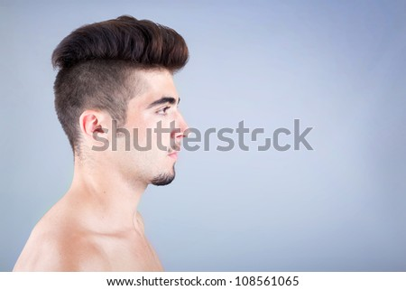 Young man profile with copyspace on grey background