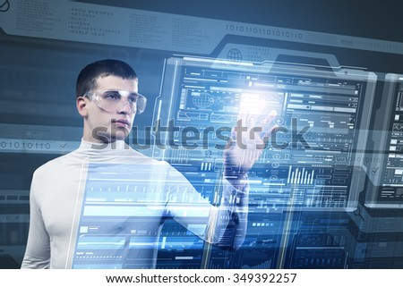 Young man pushing with finger icon on virtual screen  #349392257
