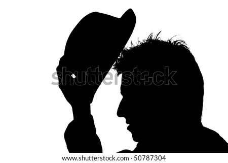 young man putting hat on his head ? silhouette