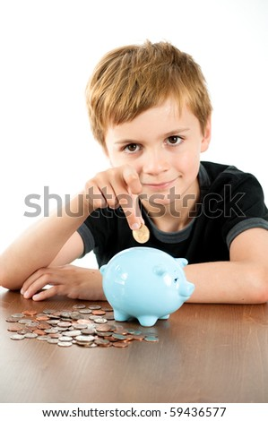 Young Man Putting Money into Blue Piggy Bank