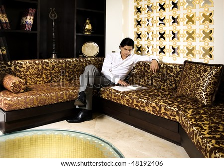 young man reading in oriental styled room