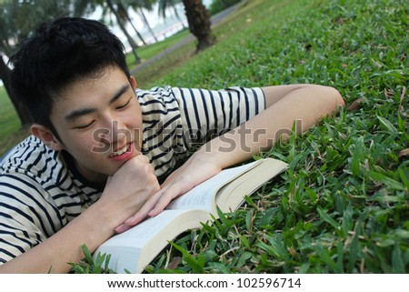 Young man reading in the park