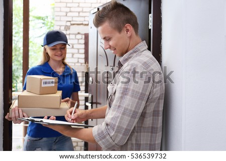 Young man receiving package from courier #536539732