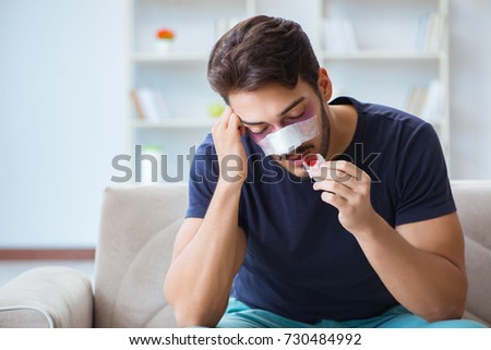 Young man recovering healing at home after plastic surgery nose  #730484992