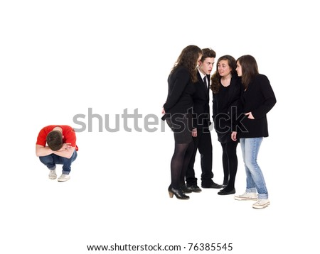 Young man rejected from the group isolated on white background