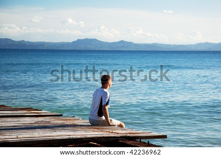 young man relax watch on ocean