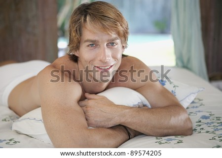 Young man relaxing in hotel room on vacation.