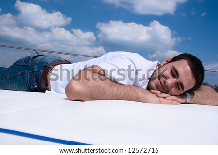 young man relaxing on a boat deck