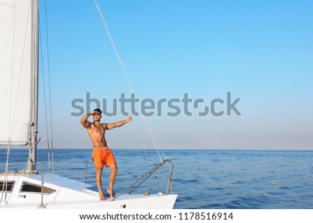 Young man relaxing on yacht during sea trip #1178516914